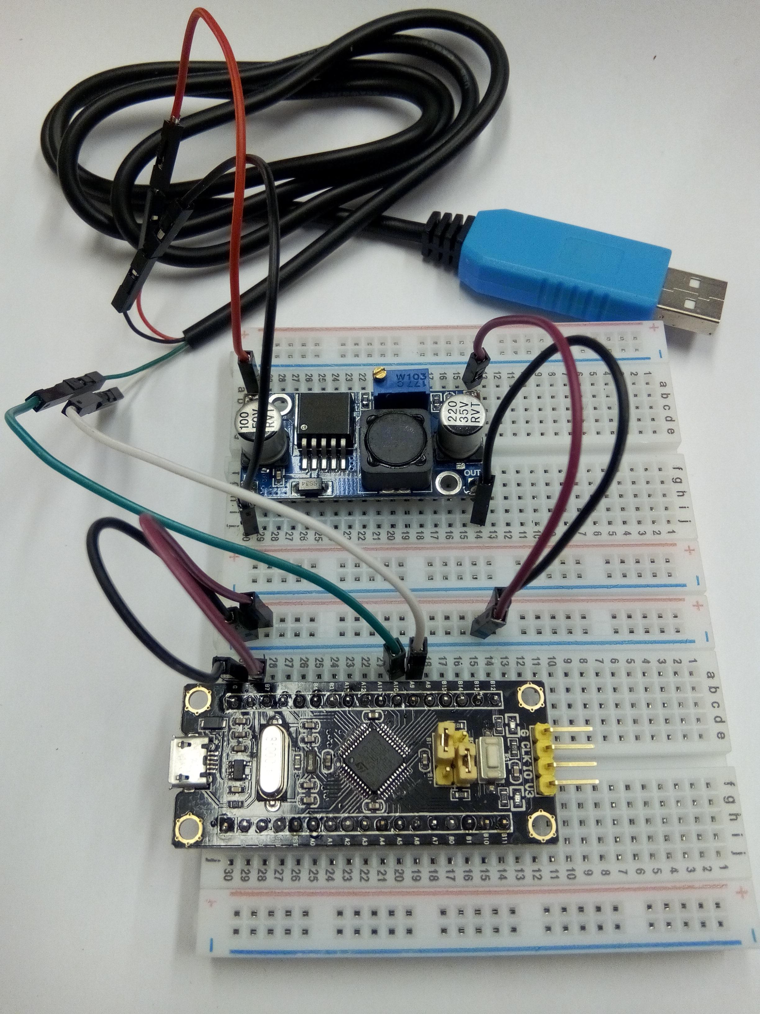USB-Ser 5V mit Spanungsregler dazwischen zum brennen des Chips